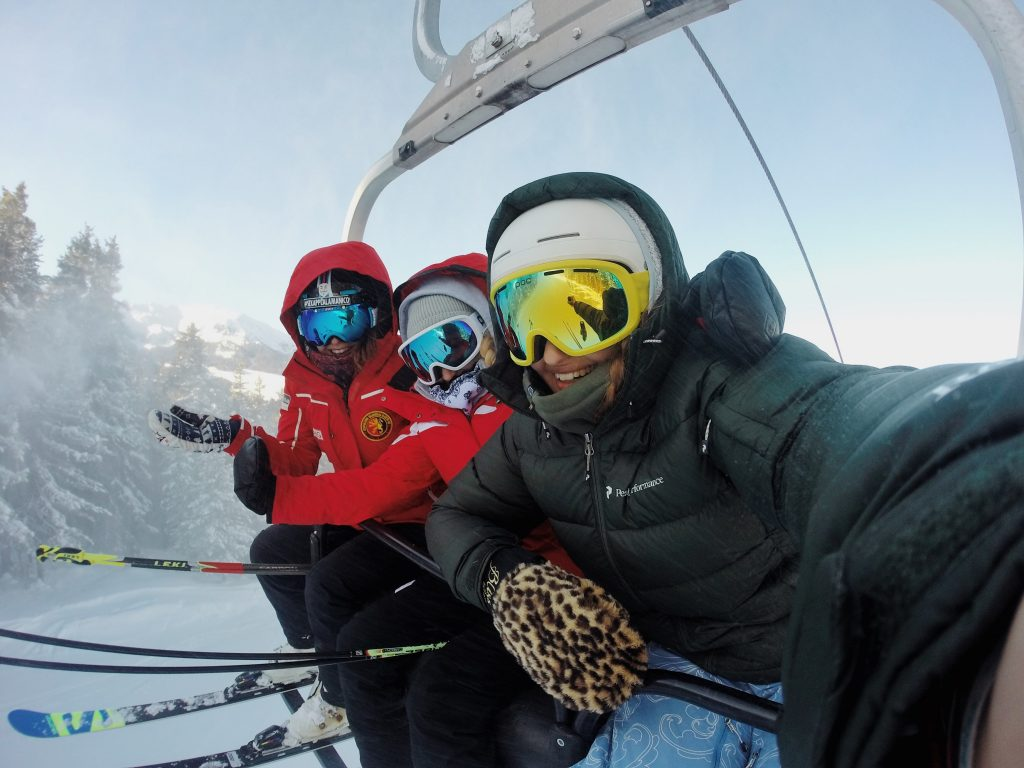 friends on ski lift smiling